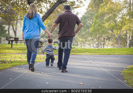 Happy Mixed Race Ethnic Family Walking In The Park stock photo, Happy Young Mixed Race Ethnic Family Walking In The Park. by Andy Dean