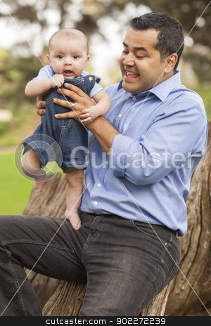 Handsome Hispanic Father and Son Posing for A Portrait stock photo, Handsome Hispanic Father and Son Posing for A Portrait in the Park. by Andy Dean