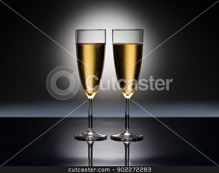 Champagne glasses stock photo, Champagne glass in front of a spotlight by Ulrich Schade