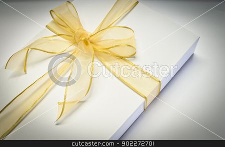 White gift box  stock photo, White gift box with gold bow  by boonsom