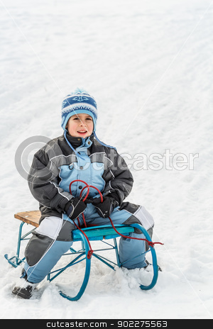 Kid sliding stock photo, Kid sliding with sledge in the snow by Grafvision