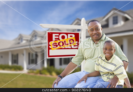 Father and Son In Front of Sold For Sale Sign and House stock photo, African American Father and Son In Front of Sold For Sale Real Estate Sign and New House. by Andy Dean