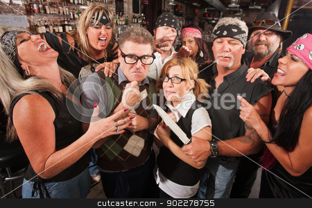 Nerd Couple Threatened by Gang stock photo, Intimidated nerd couple surrounded by laughing gang with dagger by Scott Griessel