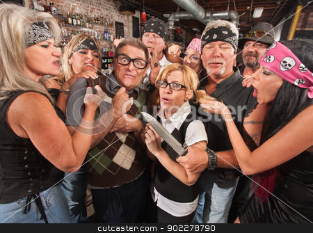 Scared Nerds with Gang stock photo, Scared nerd couple in tavern with rowdy gang by Scott Griessel
