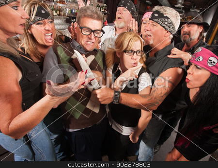 Man Threatening Nerds with a Knife stock photo, Man with biker gang threatening nerd couple by Scott Griessel