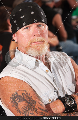 Serious Mature Thug stock photo, Serious male gang member with folded arms by Scott Griessel