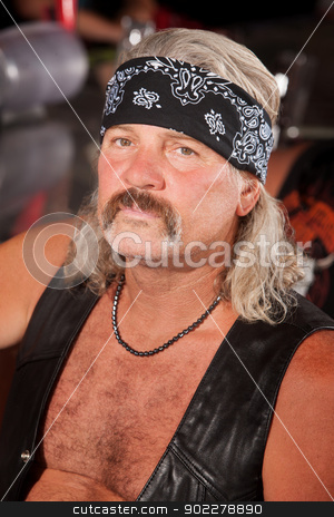 Tough Biker Gang Member stock photo, Tough Caucasian gang member with leather vest by Scott Griessel