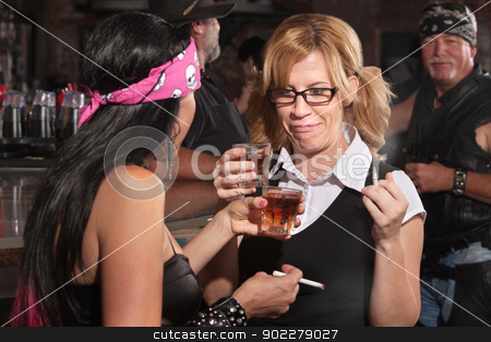 Nerd and Friend Drinking and Smoking stock photo, Nerd and female biker with cigarettes and whiskey by Scott Griessel