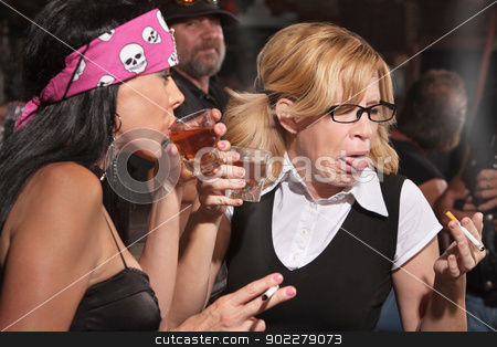 Nerd Reacting to Whiskey in Tavern stock photo, Female nerd sticking out tongue after tasting whiskey in bar by Scott Griessel