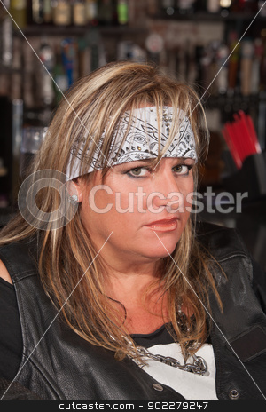 Mature Adult with Bad Attitude stock photo, Woman with bad attitude in a bar by Scott Griessel