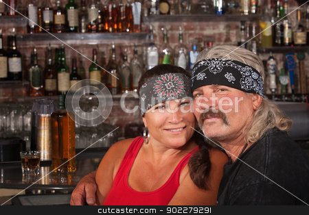 Loving Husband and Wife in Bandannas stock photo, Cute motorcycle gang husband and wife together in bar by Scott Griessel