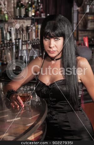 Serious Pretty Woman at Bar stock photo, Serious Caucasian woman in black dress at a bar by Scott Griessel