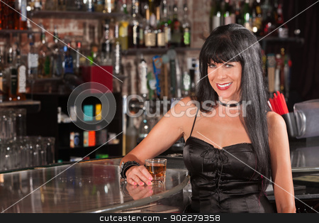 Pretty Smiling Woman at Bar Counter stock photo, Sexy European woman in black dress smiling at a bar by Scott Griessel