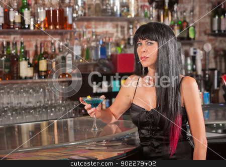 Thoughtful Woman in Bar with Martini stock photo, Thoughtful woman in black with martini in a bar by Scott Griessel