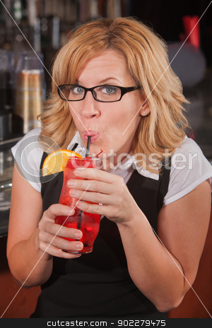Happy Lady Sipping Drink stock photo, Mature blond female sipping drink with a straw by Scott Griessel