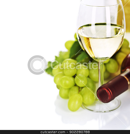 Wine stock photo, A glass of white wine and grape over white by klenova