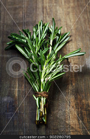Rosemary stock photo, Rosemary bound on a wooden board by klenova