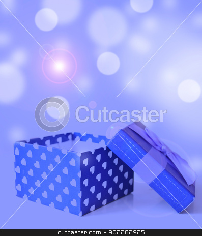 jewellery box stock photo, blue jewellery box with ribbon in bukeh background by Desislava Dimitrova