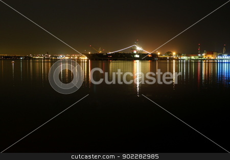 San Diego Navy Harbor Night stock photo, The skyline of San Diego Navy harbor at night with reflection in the water. by Henrik Lehnerer