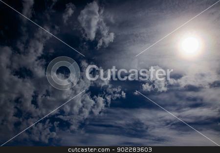 Sky with sun stock photo, Dark blue sky with scattered clouds and sun by Harvepino