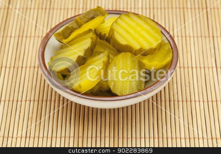 slices of cucumber pickles stock photo, sauce dish with slices of cucumber pickles on a bamboo mat by Marek Uliasz