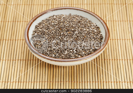 bowl of chia seeds stock photo, chia seeds in a ceramic  bowl against bamboo mat by Marek Uliasz