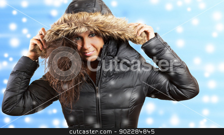 Portrait of a nice woman in winter stock photo, Studio portrait of a young woman and winter background by tristanbm
