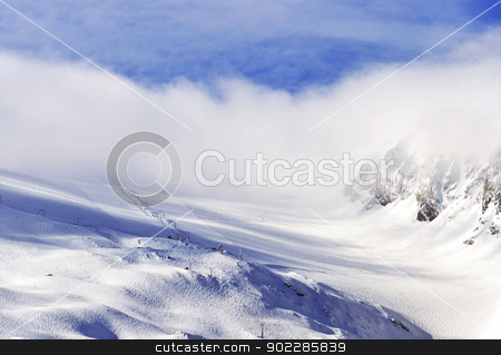 Glacier in Fog  stock photo, Hintertux Glacier in Zillertal Alps in Austria in morning fog and sunrise light with ski runs, pistes and ski lifts. by Krzysztof Nahlik