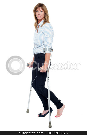 Pensive looking woman using crutches to walk stock photo, Sad woman with stiletto in one leg walking with the help of crutches. by Ishay Botbol   