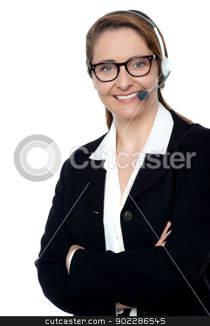 Customer support executive posing confidently stock photo, Lady with microphone headset on ready to assist you. Posing confidently with folded arms. by Ishay Botbol