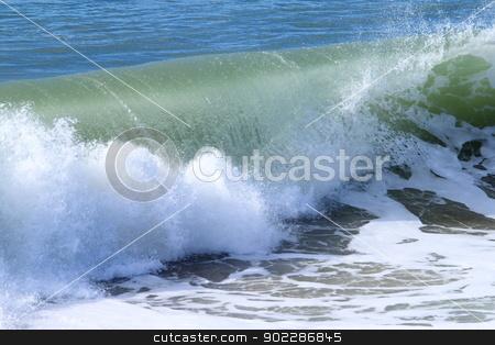 Wave stock photo, Closeup of a wave breaking near the beach. by Henrik Lehnerer