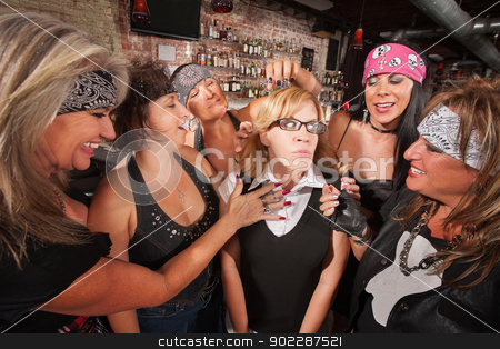 Gang Touching Nerd's Hair stock photo, Female motorcycle gang touching a frightened nerd by Scott Griessel