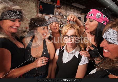 Cruel Women Teasing Nerd stock photo, Cruel gang of mature women teasing a nerd in a bar by Scott Griessel
