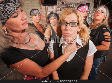 Scared Nerd with Tough Woman stock photo, Tough biker gang woman with hand near female nerd's neck by Scott Griessel