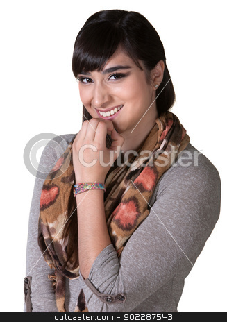 Giggling Hispanic Female stock photo, Grinning female hipster with fingers on chin by Scott Griessel