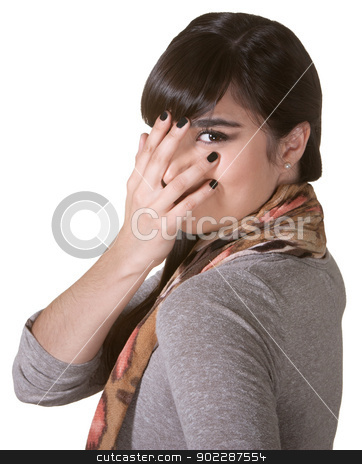 Coy Hispanic Female stock photo, Coy Hispanic female hiding part of face with hand by Scott Griessel