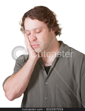 Sad Man Looking Down stock photo, Sad Caucasian male with hand on cheek looking down by Scott Griessel