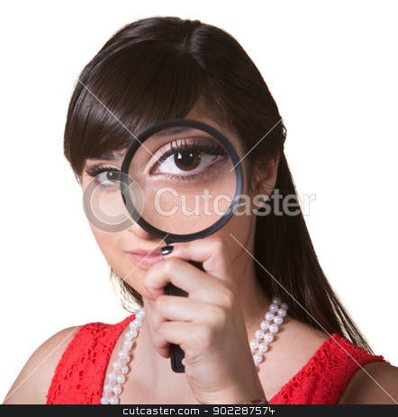Woman with Magnifying Glass stock photo, Cute young woman holding a magnifying glass over her eye by Scott Griessel