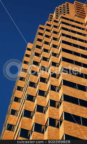 Tan Skyscraper Blue Sky stock photo, Close up vertical view of modern tan office building on a clear day by bobkeenan