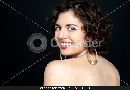 Sexy model turning back and smiling stock photo, Hot model on black background turning back and smiling, being flirtatious. by Ishay Botbol
