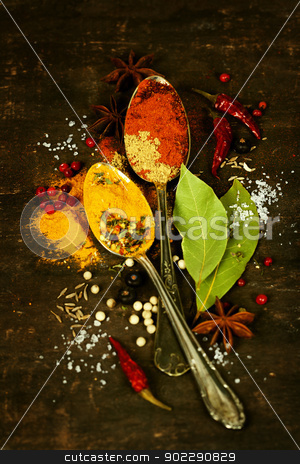 spices on a wooden board stock photo, Bright spices on an old  wooden board by klenova