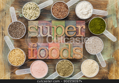 superfoods stock photo, superfoods word in letterpress wood type surrounded by plastic scoops of healthy seeds and powders (chia, flax, hemp, pomegranate fruit powder, wheatgrass,  whey protein, maca root) - top view by Marek Uliasz