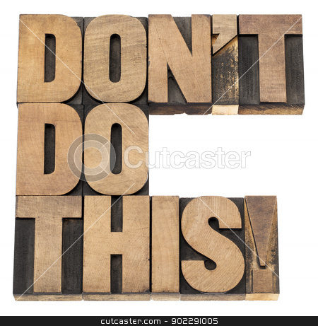do not do this warning stock photo, do not do this warning -  isolated text in vintage letterpress wood type printing blocks by Marek Uliasz