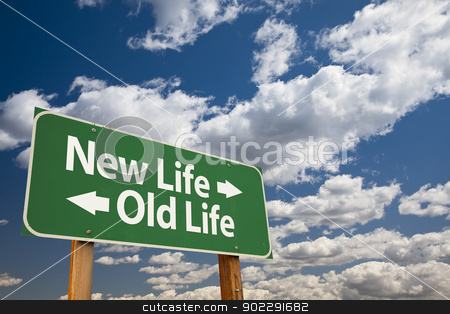 New Life, Old Life Green Road Sign Over Clouds stock photo, New Life, Old Life Green Road Sign Over Dramatic Clouds and Sky. by Andy Dean