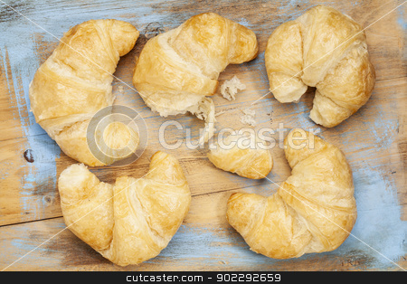 croissant bakery stock photo, croissant rolls on a grunge painted wood board by Marek Uliasz