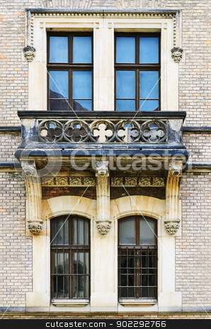 Windows stock photo, Four Windows And Balcony On The Facade Of The Building by Sergej Razvodovskij
