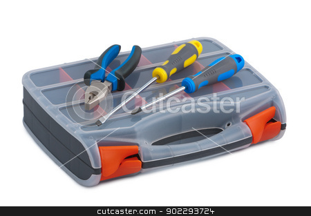 Screwdriver and pliers in a plastic tool box on white background stock photo, Screwdriver and pliers in plastic tool box on white background. by Borys Shevchuk