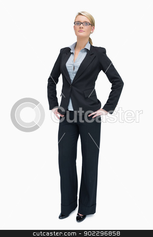 Successful businesswoman standing stock photo, Successful businesswoman standing with her hands on the hip by Wavebreak Media