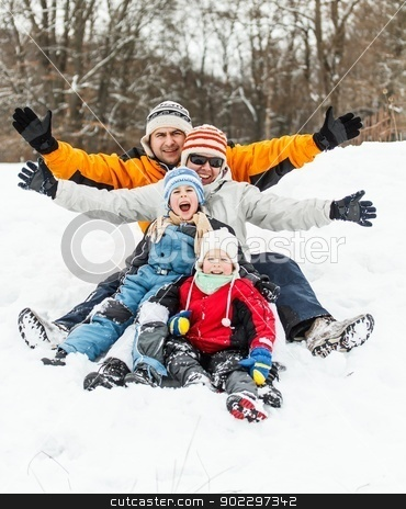Happy family stock photo, Happy family having fun in the snow by Grafvision