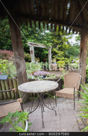 Garden with furniture stock photo, Green garden wth garden furniture by Wavebreak Media